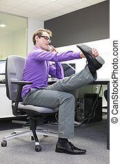 caucasian man office worker with phone in hand, stretching legs