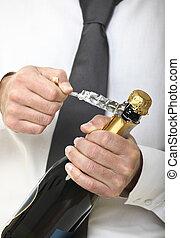 man open champagne bottle