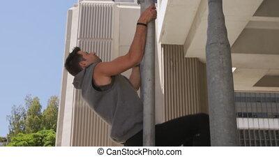 Caucasian man practicing parkour