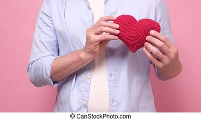 Caucasian man receiving red heart. Like in social media concept.