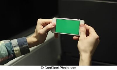 Caucasian Man Show Green Screen Phone on Train