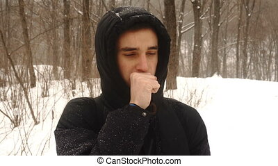 Caucasian man smelling stinky crinkle face on white snow...