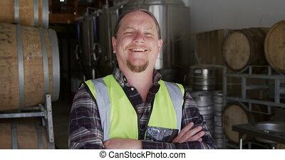 Caucasian man smiling at camera and wearing high visibility ...