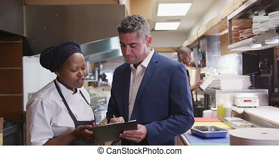 Caucasian man talking to a cook - Front view of a Caucasian ...