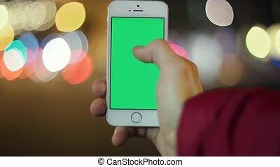 Caucasian Man Uses His Smart Phone in Hand, City
