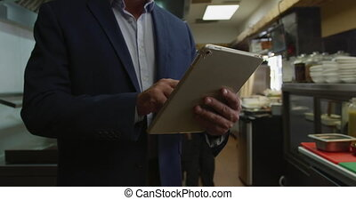 Caucasian man using a touch pad - Front view mid section of...