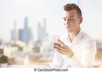 Caucasian man using cellphone