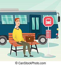 Caucasian man waiting for a bus at the bus stop. - Caucasian...