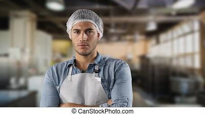 Caucasian man wearing a protective cap and white apron In a ...