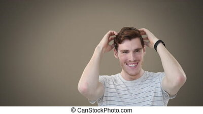 Caucasian man wearing a stripped t-shirt laughing and ...