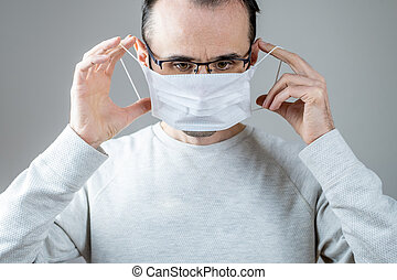 Caucasian man wearing a white medical mask for protection ...