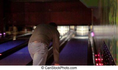 Caucasian man with a beard playing bowling