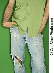 Caucasian man with torn jeans. - Mid body portrait of ...