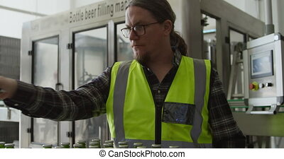 Caucasian man working at a microbrewery - A Caucasian man ...
