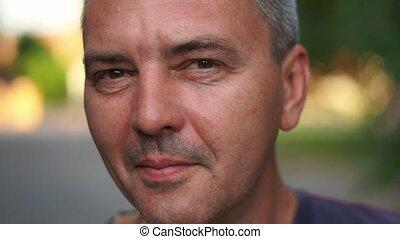 Caucasian mature man close up portrait. Real people authentic lifestyle portrait. High quality photo