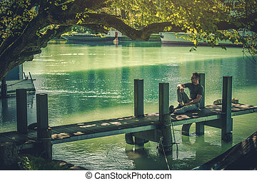 Caucasian Men Relaxing on the Small Wooden Pier