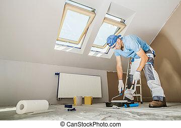 Caucasian Men Repainting His Apartment Walls