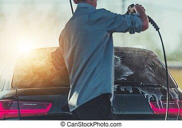 Men Washing His Car