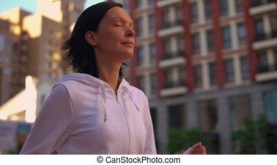 caucasian model jogging outdoors