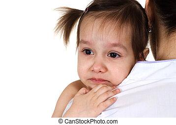 Caucasian nurse holding a baby girl