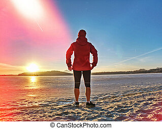 Caucasian person with slim body doing exercises and jogging