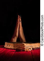 Caucasian praying female hands.