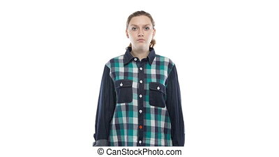 Caucasian pregnant woman in green plaid shirt