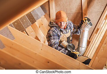 Technician Installing Home Ventilation Elements