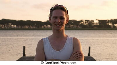 Caucasian rower standing on jetty and looking at camera - ...