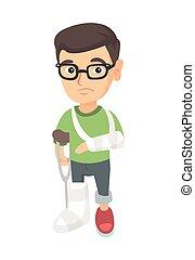 Caucasian sad injured boy with broken arm and leg.