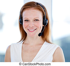 Caucasian sales representative woman with an headset against...