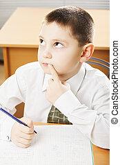 Caucasian schoolboy looking up