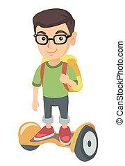 Caucasian schoolboy riding on gyroboard to school. - Joyful...
