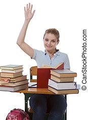 Caucasian schoolgirl with raised hand in class - High school...