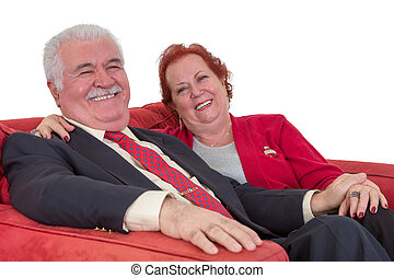 Caucasian senior couple smiling and holding hands