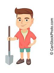 Caucasian smiling boy holding a shovel.