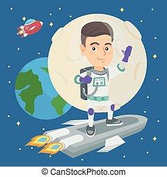 Caucasian smiling boy riding a space rocket.