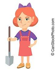 Caucasian smiling girl holding a shovel.