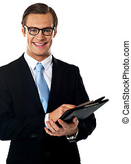 Caucasian smiling young businessman holding a folder