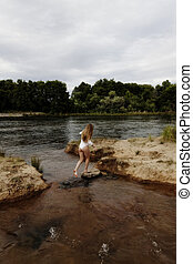Caucasian Teen Girl At River In White Leotard From Back