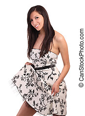 Caucasian Teen Girl in dress holding up hem