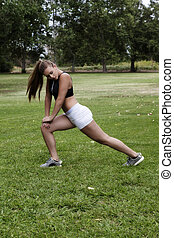 Caucasian Teen Girl Stretching In White Shorts Black Top