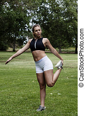 Caucasian Teen Woman Outdoor Stretching Leg In Park