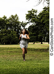 Caucasian Teen Woman Running In Park Gray Dress
