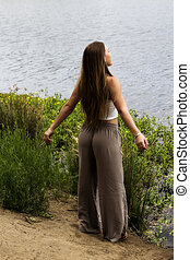 Caucasian Teen Woman Standing At River Edge