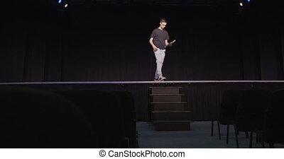 Caucasian teenage boy in the high school auditorium ...