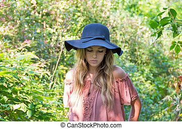 Caucasian teenage girl in summer woods