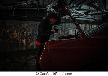 Caucasian Thief Looking Inside Car Trunk
