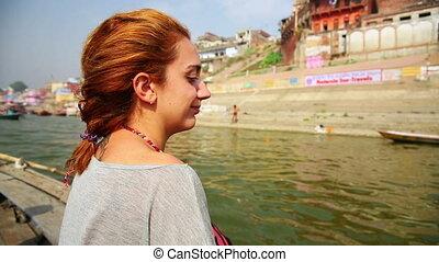 Caucasian tourist girl, indian boat, varanasi ganges river,...