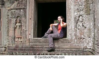 caucasian tourist in angkor wat